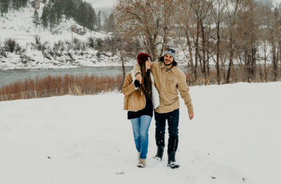 In snake river canyon wyoming a man walks with his fiance as they laugh together