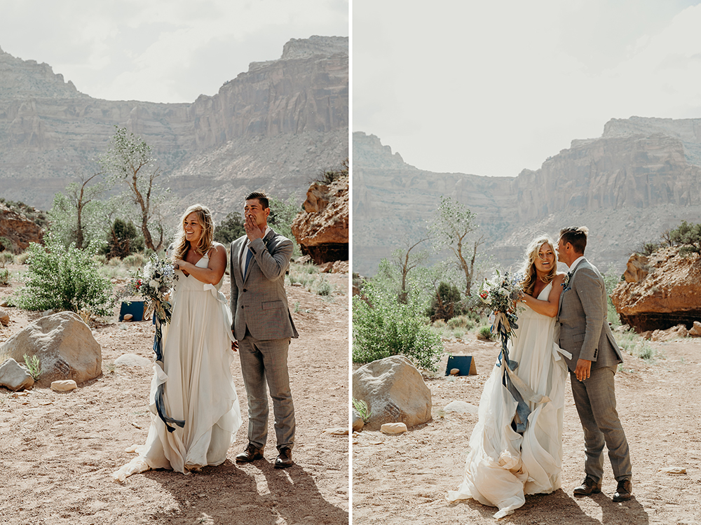 Couple smile, cry and embrace as they walk toward their backcountry utah wedding ceremony