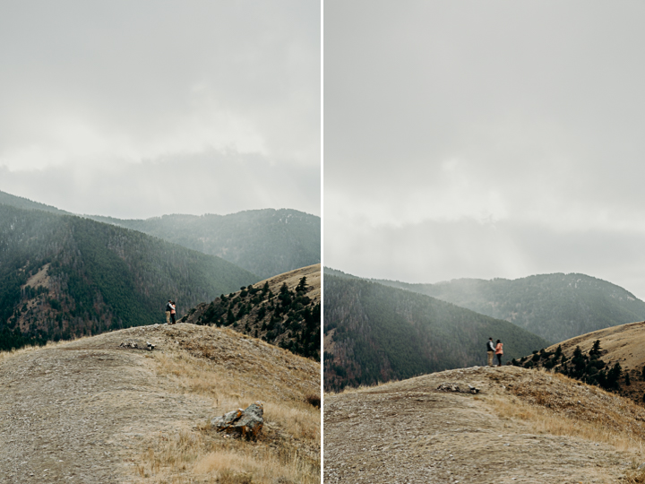 Couple embrace on a mountaintop in Grand Teton National Park
