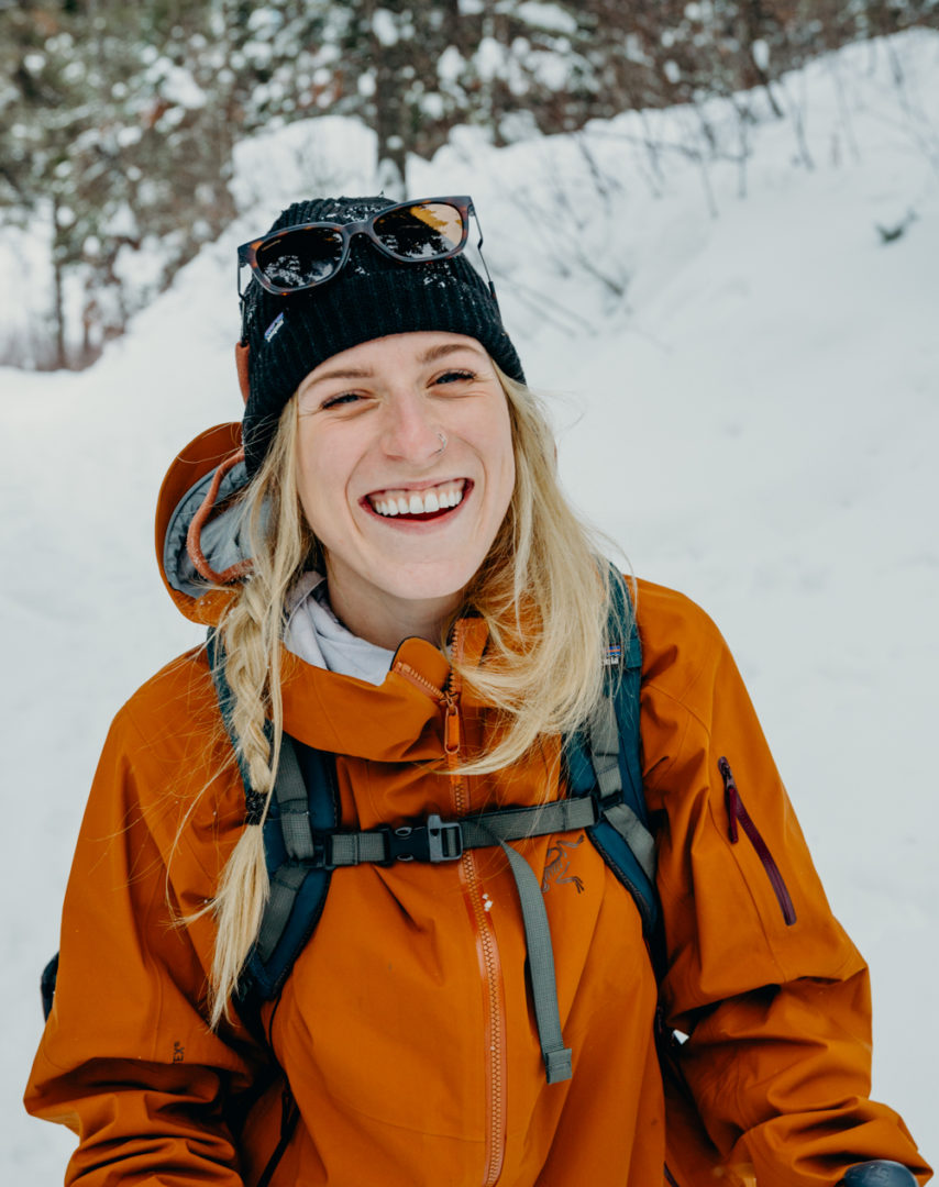Woman smiling in backcountry ski clothing Erin Wheat
