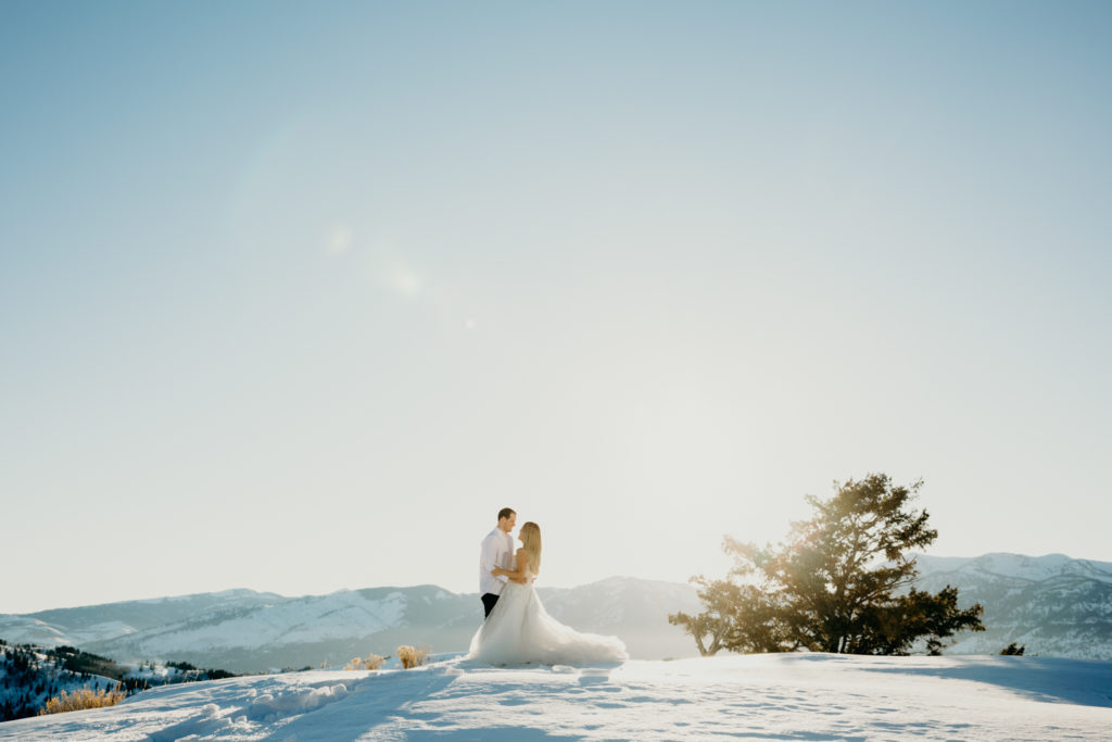 Wedding portraits during sunset at Amangani Resort in Jackson Hole Wyoming during late winter